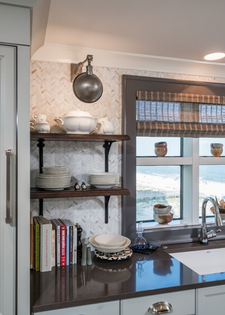 Small Kitchen design with Earth toned countertop, open shelves and sconce.