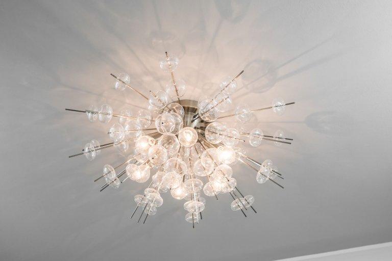White Design with Artisan Glass lighting.