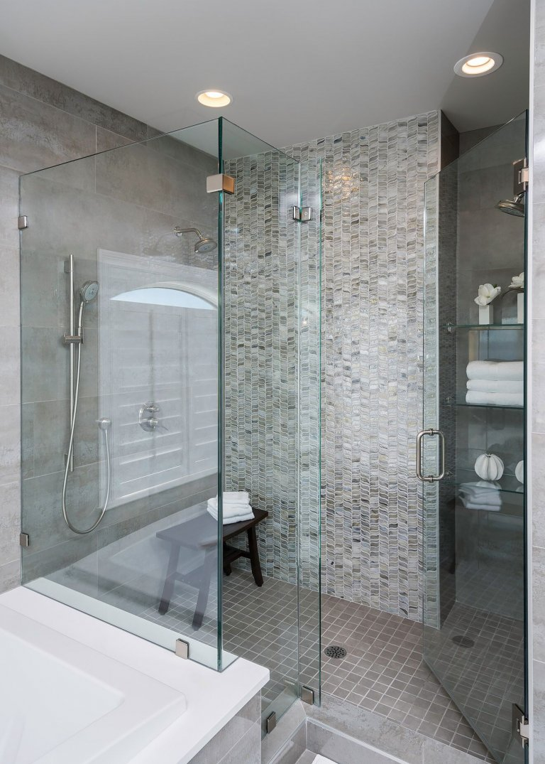 Walk In Shower with grey Tile and glass doors for a bathroom remodel in Pensacola Florida
