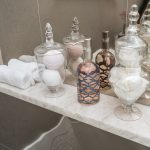 bathroom marble shelf grey tile walls apothecary vases soap dispenser - Bathroom Remodel Pensacola Florida