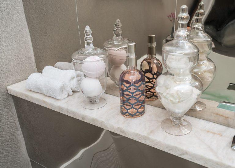 bathroom marble shelf grey tile walls apothecary vases soap dispenser - Bathroom Remodel Pensacola Florida