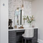 bathroom built-in vanity with grey cabinet and silver frame mirror charcoal grey floor tile