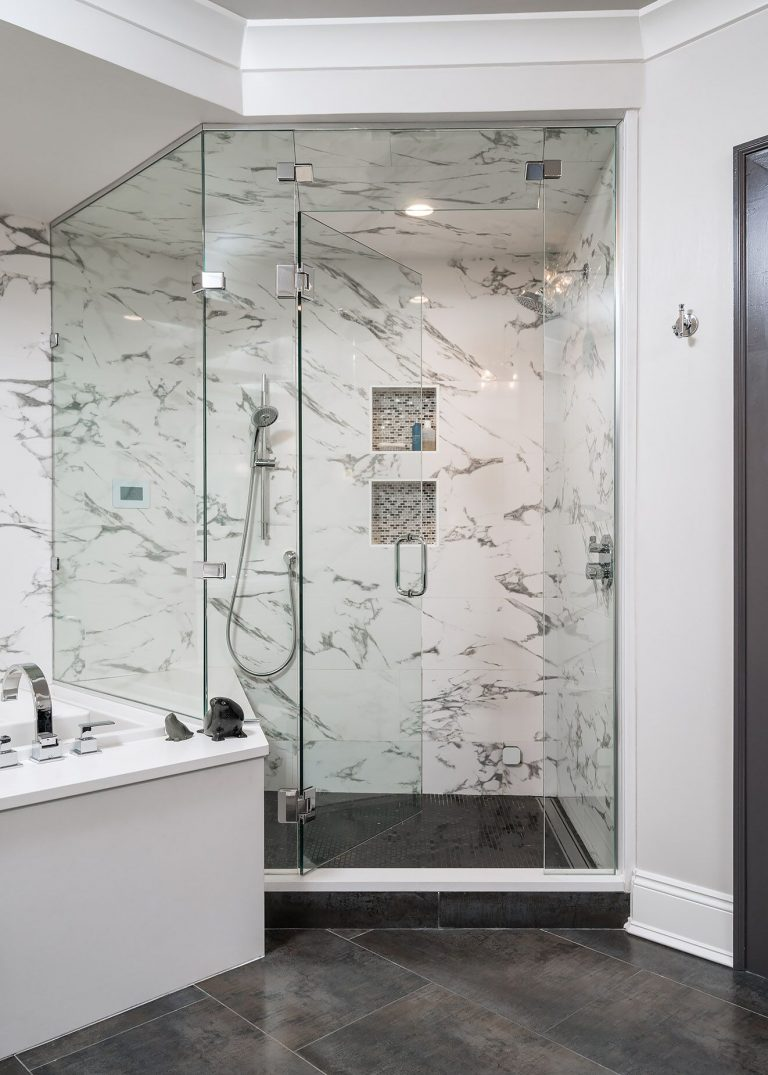 white marble bathroom glass doors charcoal grey floor tile