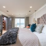 bedroom design velvet upolstered bed beach view
