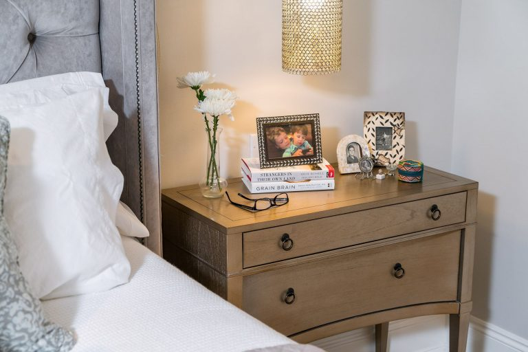 bedroom side table with hanging light upholstered velvet bed