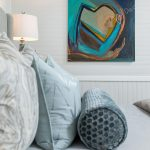 bedroom withblue heart painting elvet bolster pillow