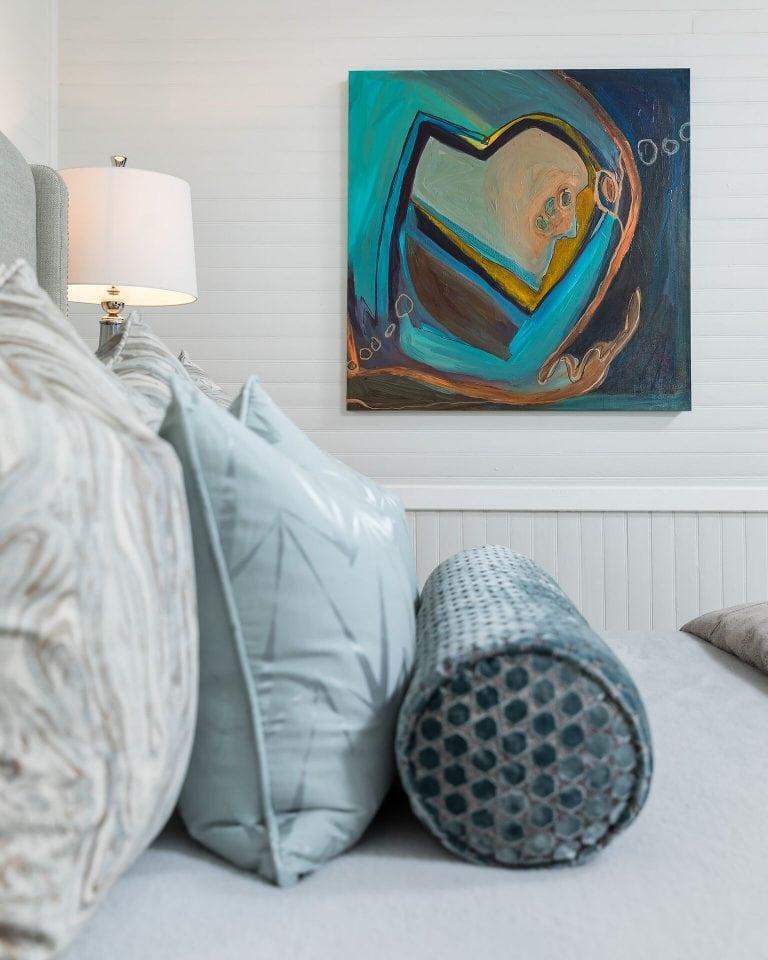 bedroom withblue heart painting elvet bolster pillow
