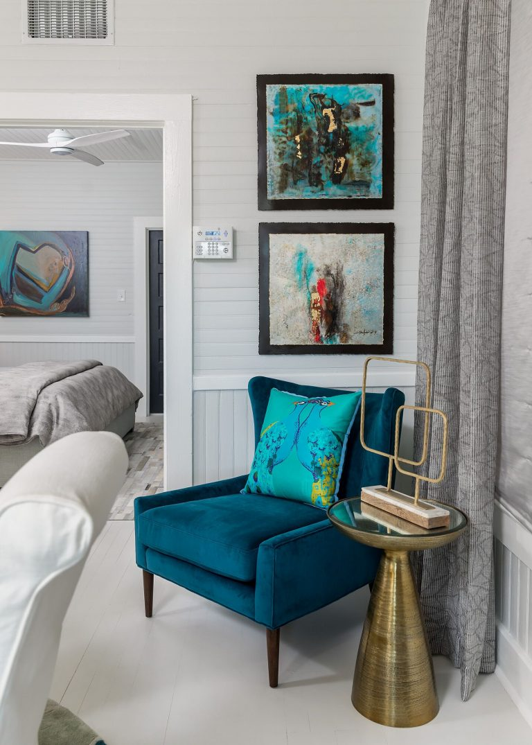 black & white cottage living room with teal velvet chair gold side table framed artwork ceiling fan bedroom