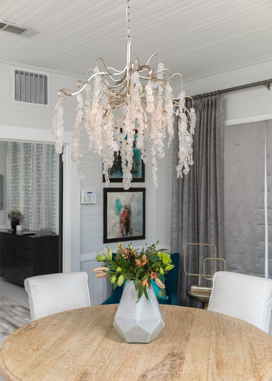 black & white cottage dining room with crystal beaded chandeiler white geometric vase