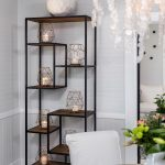 White cottage dining room open bookcase with crystal hanging light