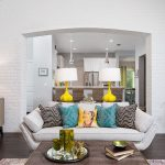 white brick living room with cute sofa colorful pillows