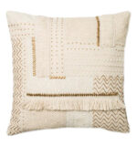 beige and brown throw pillow with beads