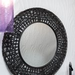 Black accent mirror and purple pendant for small bathroom remodel in Pensacola Florida
