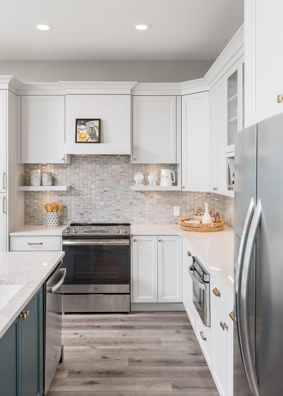 Neutral kitchen with blue accents - coastal kitchen design pensacola florida