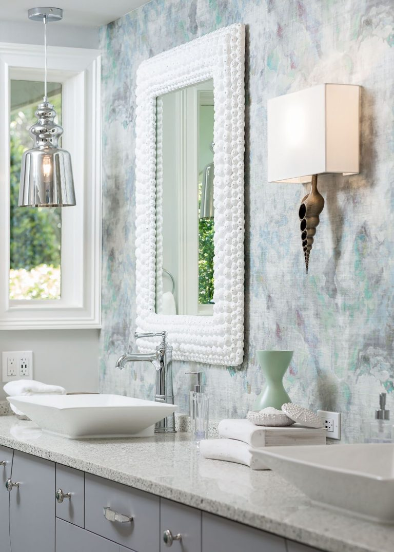 White Shell mirror with grey cabinetry and white countertop Coastal Bath Remodel Pensacola Florida