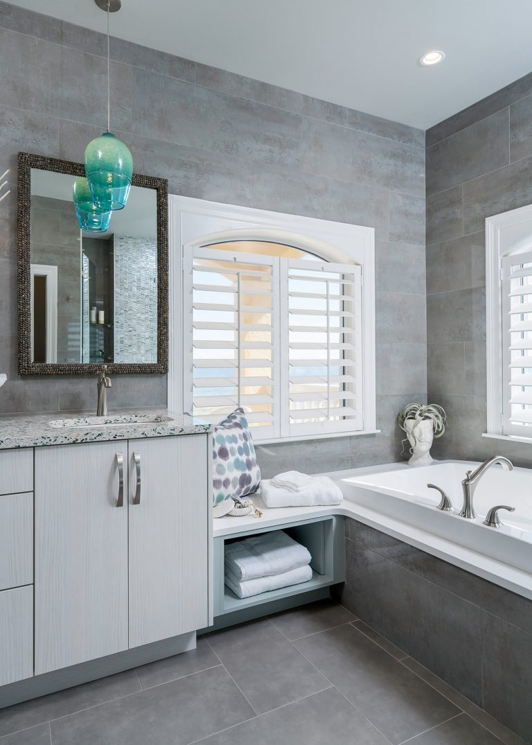 White Large Tub Neutral Colors with Blue pendants Coastal Bathroom Remodel in Pensacola Florida