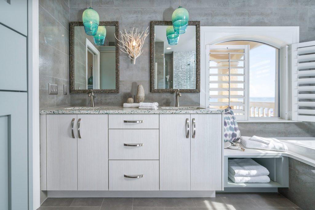Neutral Colors with Blue pendants Coastal Bathroom Remodel in Pensacola Florida