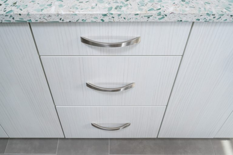 white cabinetry with silver pulls for bathroom remodel in Pensacola Florida