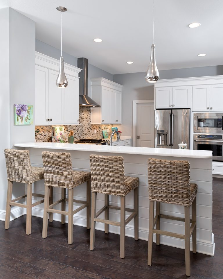 bright open concept kitchen with counter stool seating, eat in counter