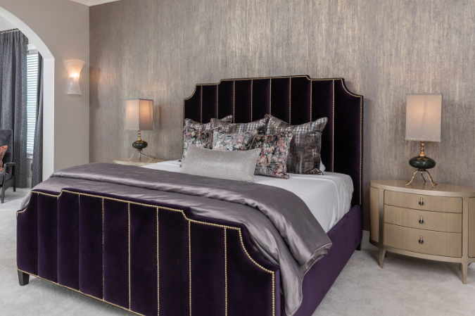 Purple and Grey Bed with light grey wallpaper