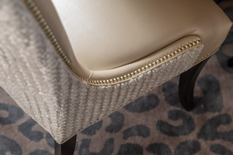 fur dining chair with metallic and nailheads