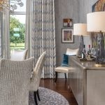 grey dining room with dining chairs and grey wallpaper