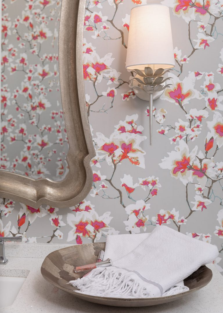 pink and grey wallpaper with silver sink