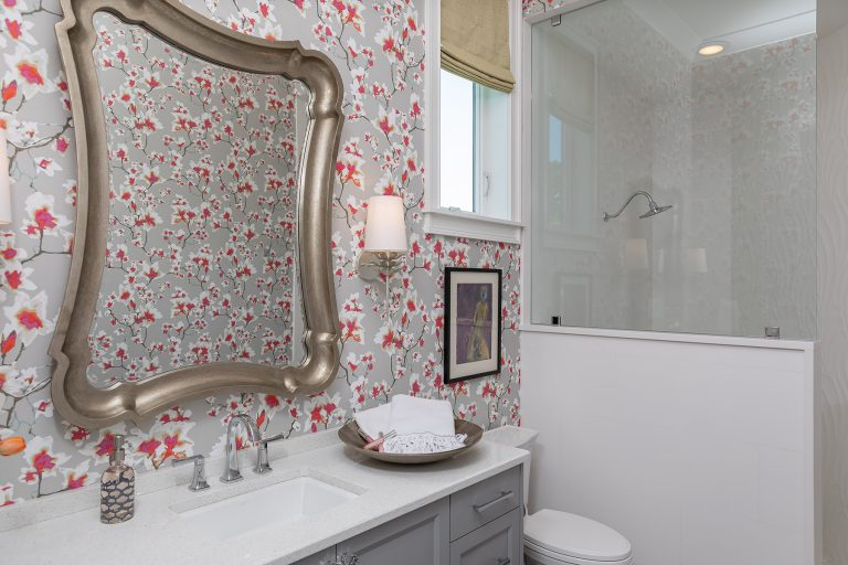 pink and grey wallpaper with silver mirror