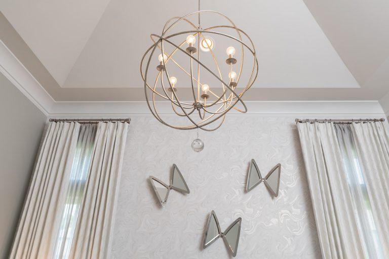 large chandelier in bedroom ceiling