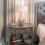 nightstand with lamp and curtains, feminine bedroom