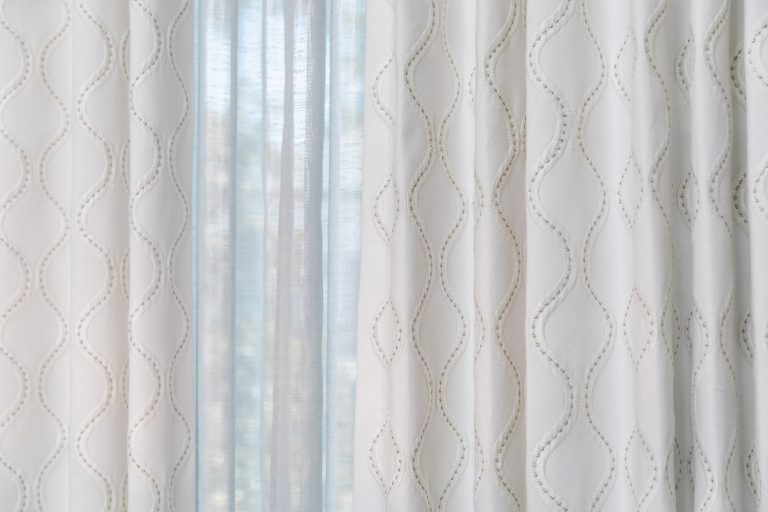 Sheer curtains light grey for a feminine bedroom