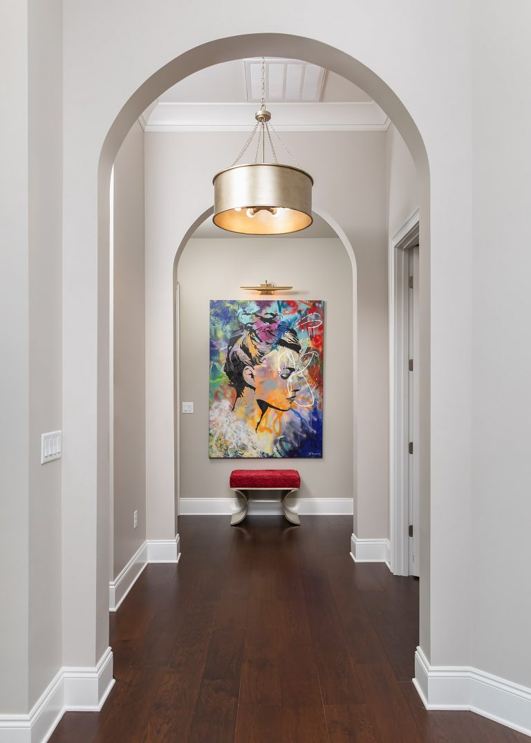 Hallway with arches and art