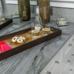 Master Bathroom grey counter top with home decor