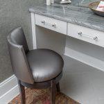 Vanity with grey chair and vintage rug