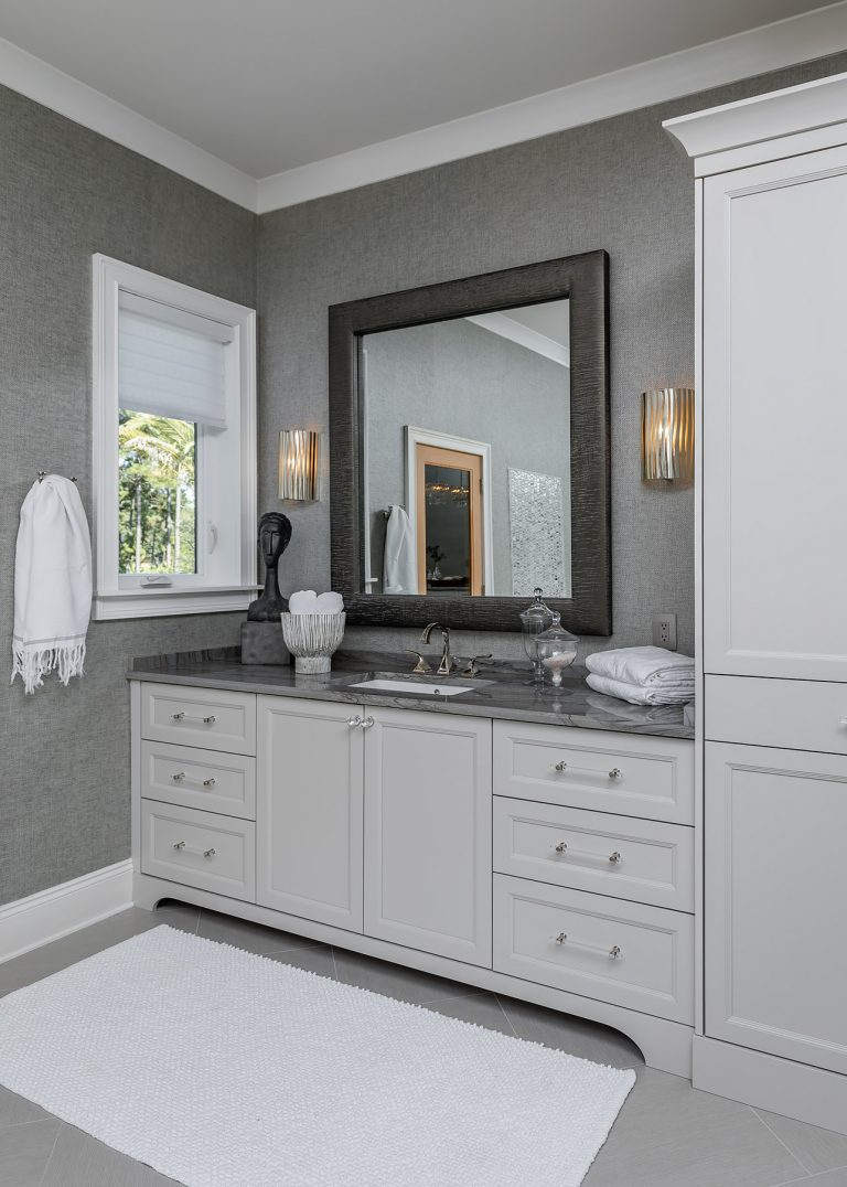 Master Bathroom Vanity with grey wallpaper and a grey mirror