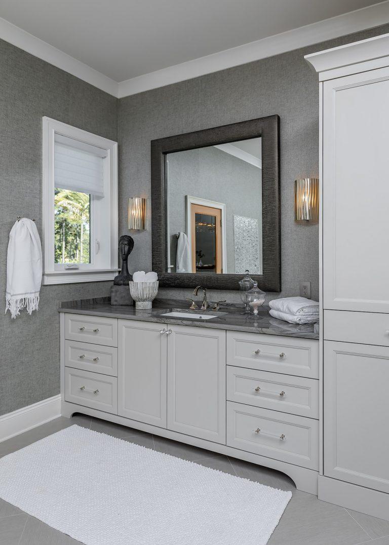 Master Bathroom Vanity with grey wallpaper and a grey mirror