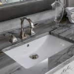 Grey Stone Counter Top with White sink and silver hardware