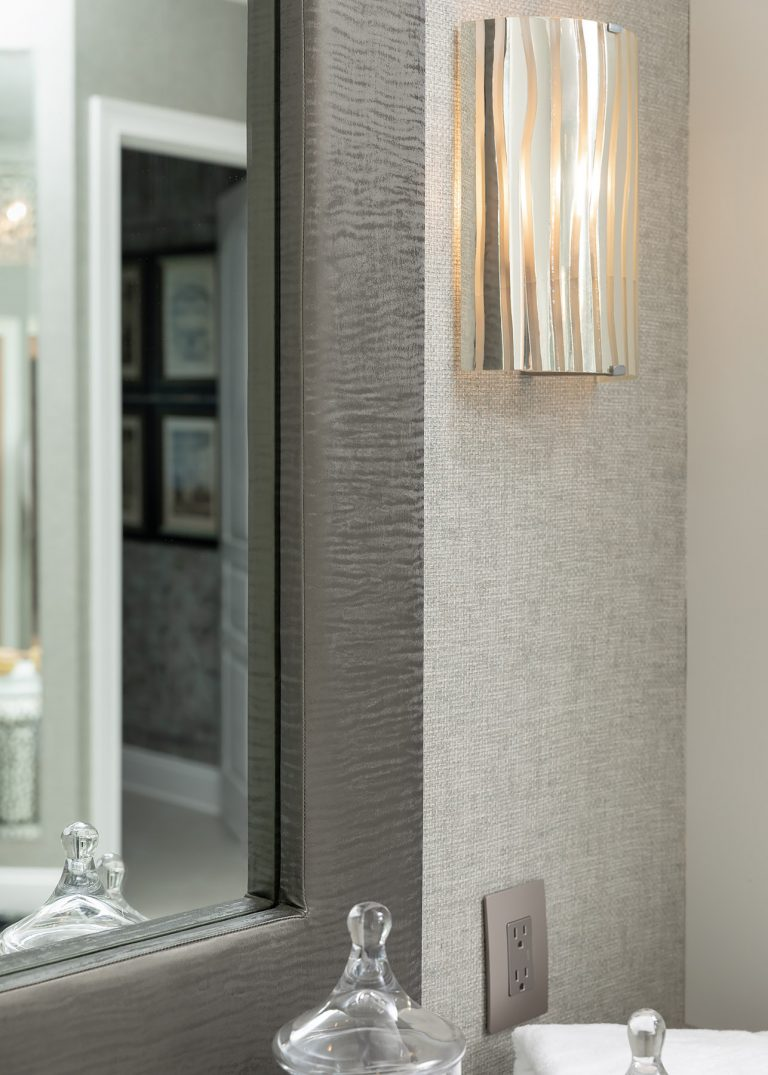 Grey wallpaper and a grey mirror for master bath