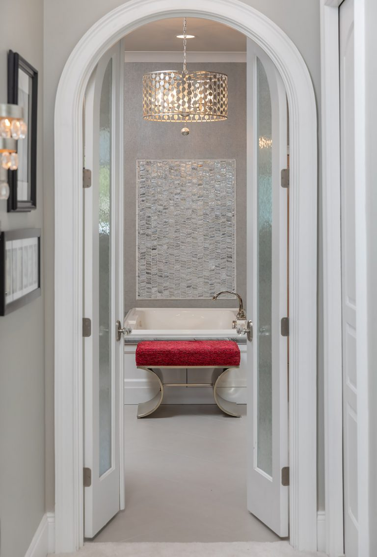 Master Closet entrance with view of tub
