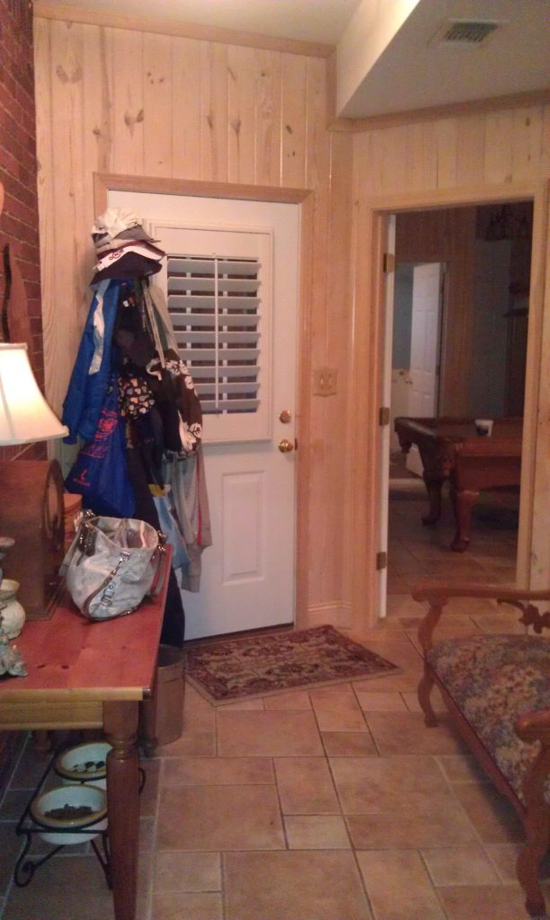 before picture of a hall used as mudroom