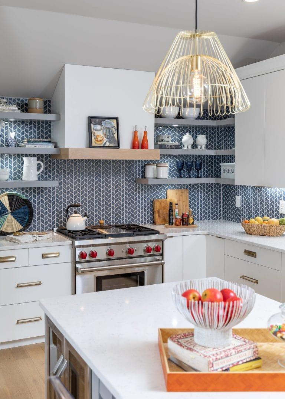 Blue tile back splash in a white and blue kitchen remodel