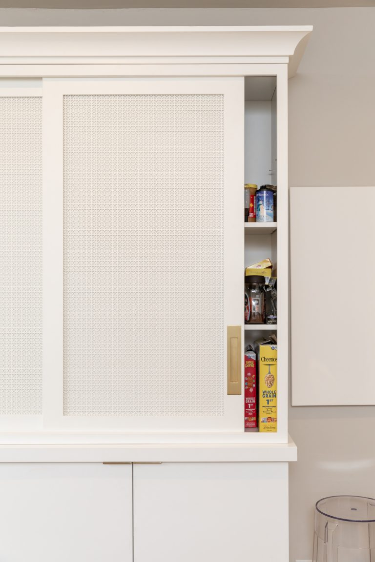 White Pantry with Pocket door and gold door hardware