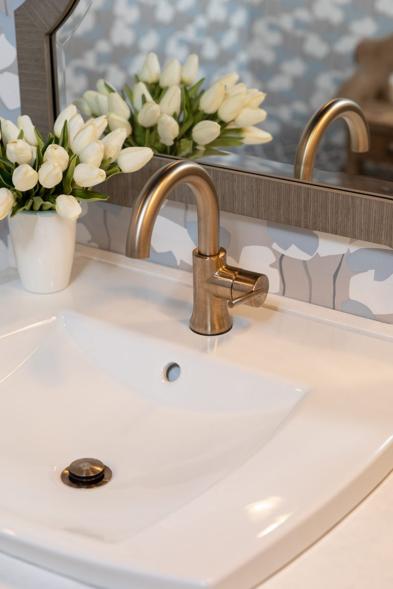 White sink with gold hardware - Blue and White Bathroom