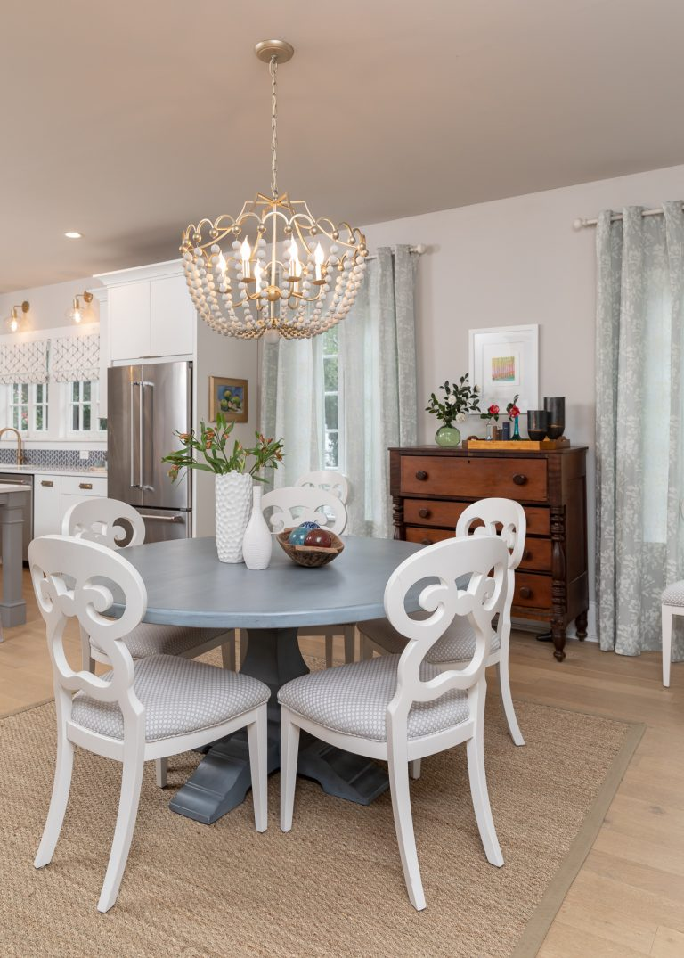White and Blue Scandinavian Breakfast room with white chandelier and blue table