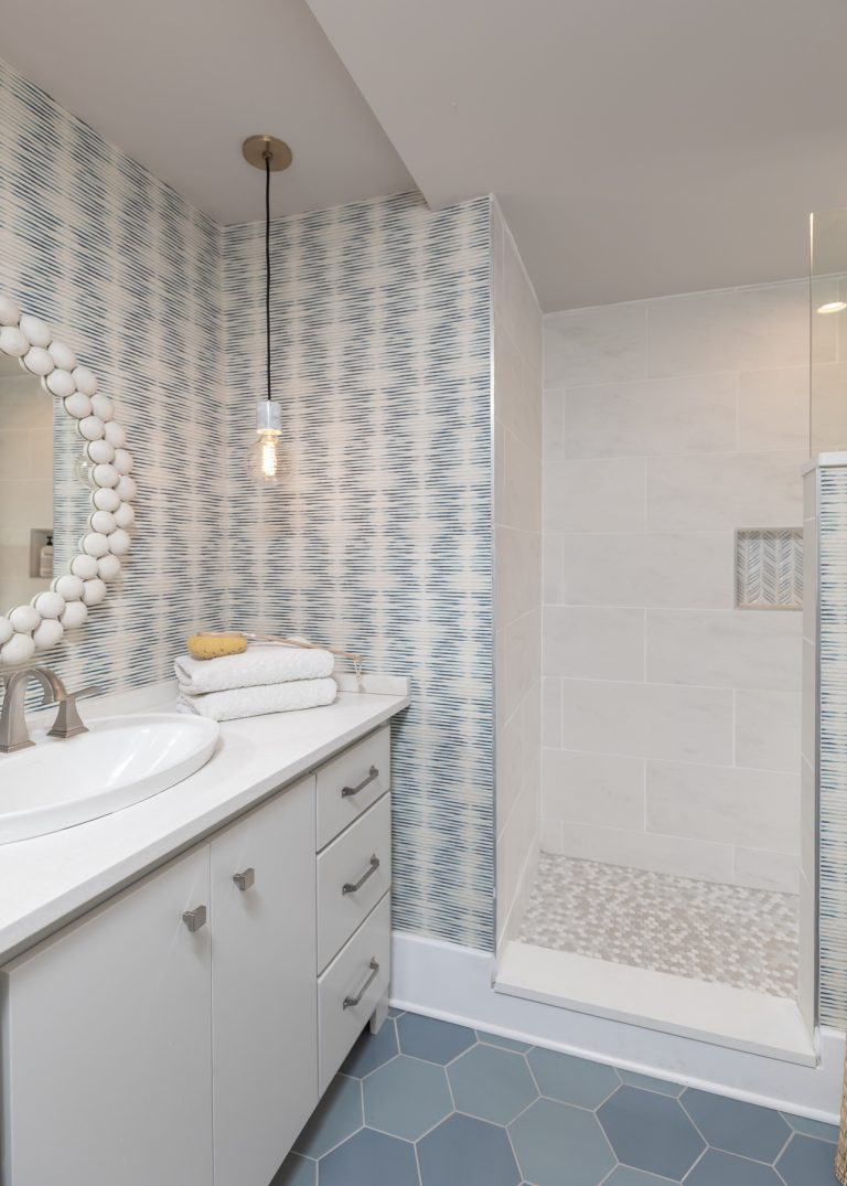 White and Blue Scandinavian Master Bathroom remodel with blue wallpaper