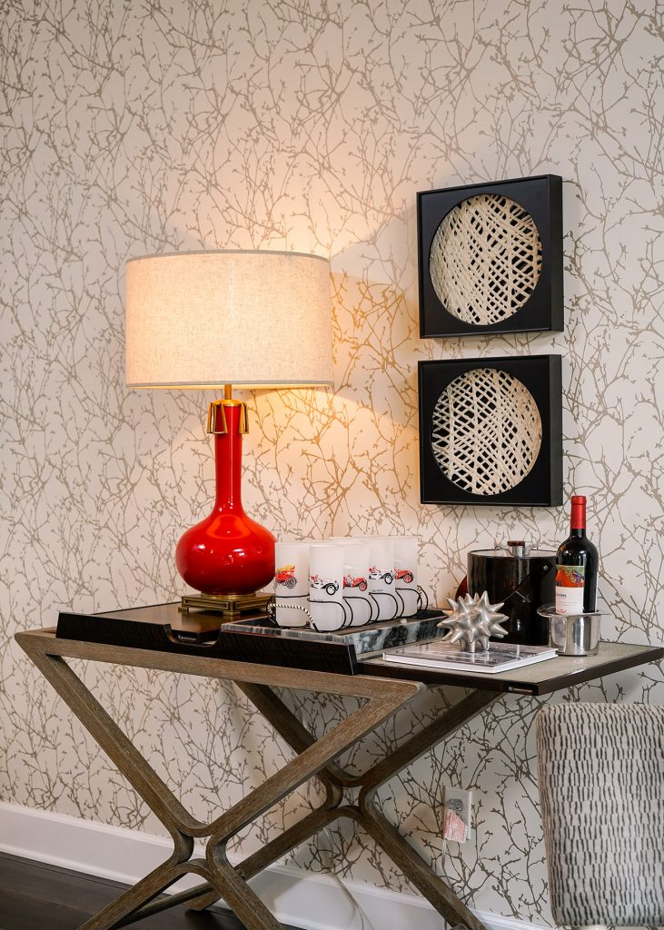red lamp on a bar with wall paper