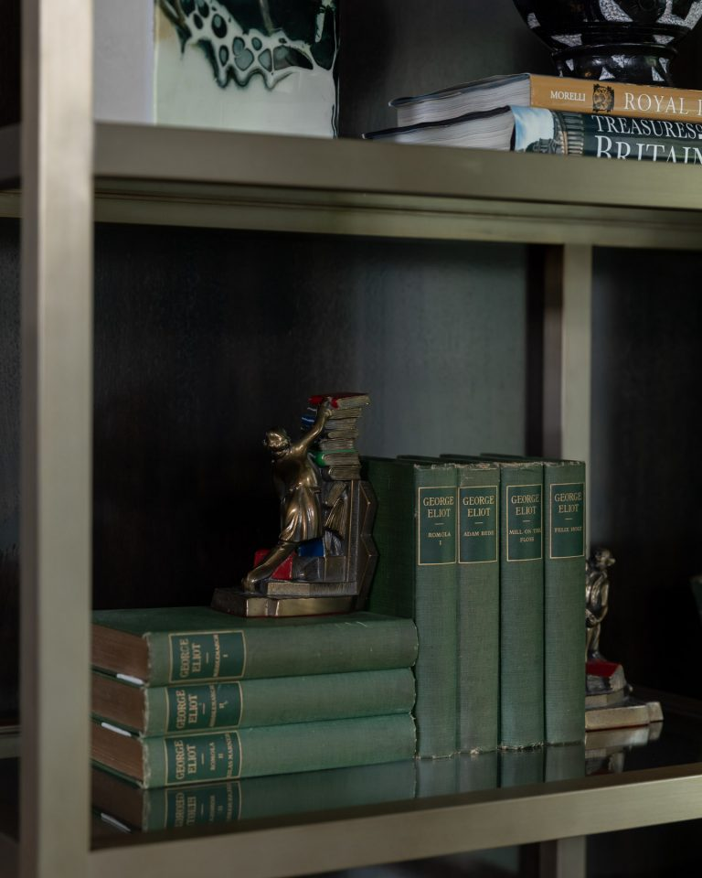 Vintage Craftsman Colonial Librarian Struggling Bookends on Book shelf