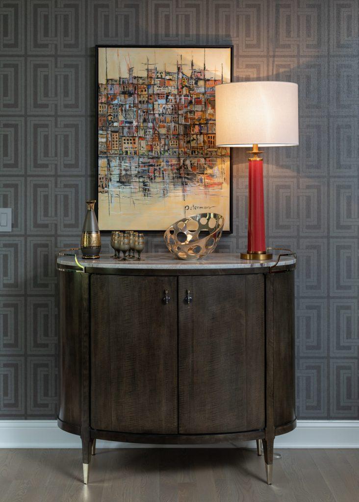 dark wood console, original art, red table lamp, grey wallpaper