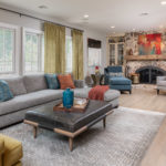 Family Room Remodel, Family Room idea, leather ottoman, blue velvet accent chair, grey sectional, colorful family room, orange accents