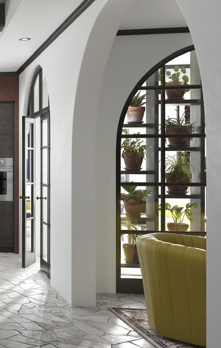 green kitchen, plant wall, arched kitchen wall, yellow accent chair, etc
